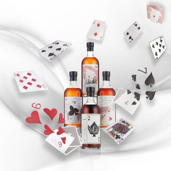 Fante di Quadri o Asse di Picche? All'asta a Hong Kong il whisky giapponese con le carte in etichetta
